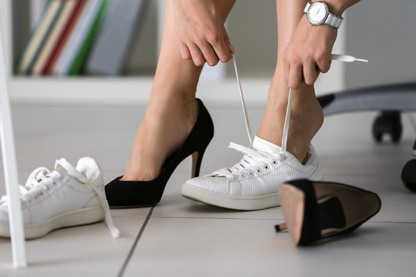 Keeping a pair of heels to change into at work is a great idea for baby faced women.