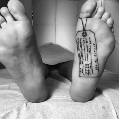 under sole morgue toe tag black and white humorous foot tattoo