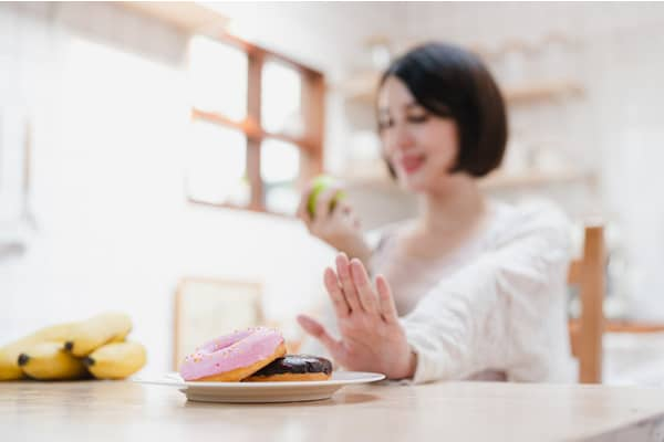 Avoid overeating and unhealthy choices during pregnancy.