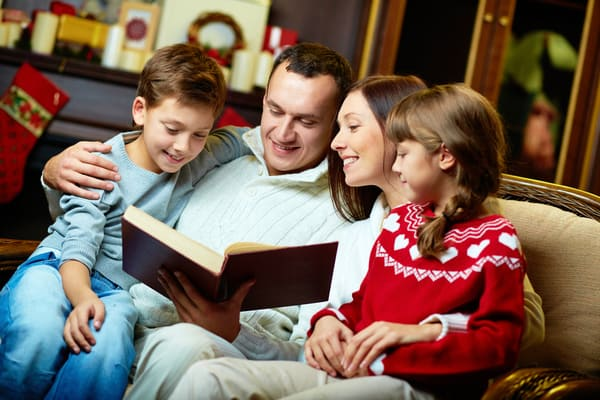 Family reading together at home