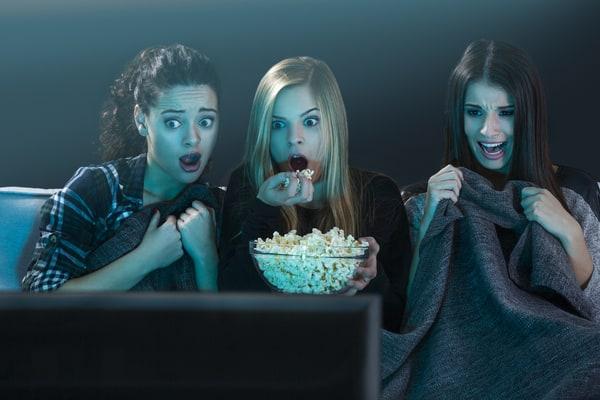 Teenage girls binge-watching movies Halloween movies